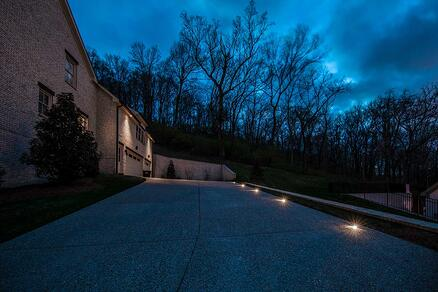 Driveway at night with flush mounted indicator lighting