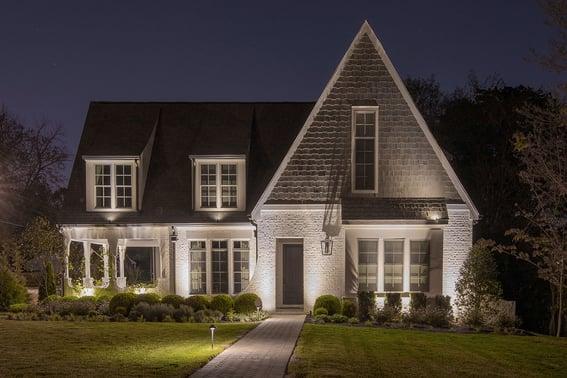 up lighting a white brick home