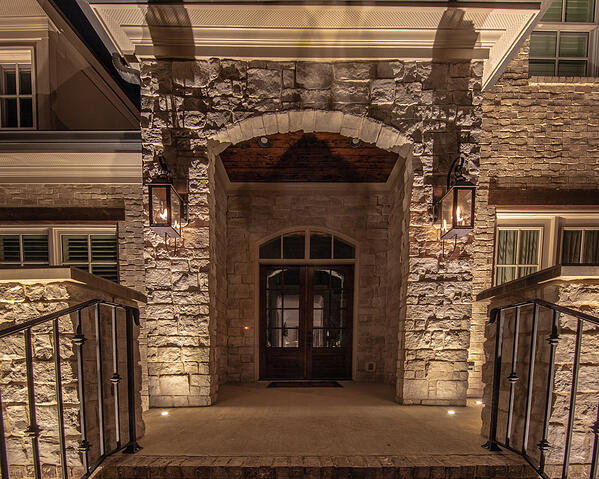 core drilled recessed up lights on front patio light stone columns at entrance to home