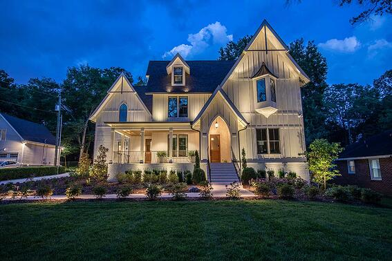 up lighting architecture on large white home in nashville