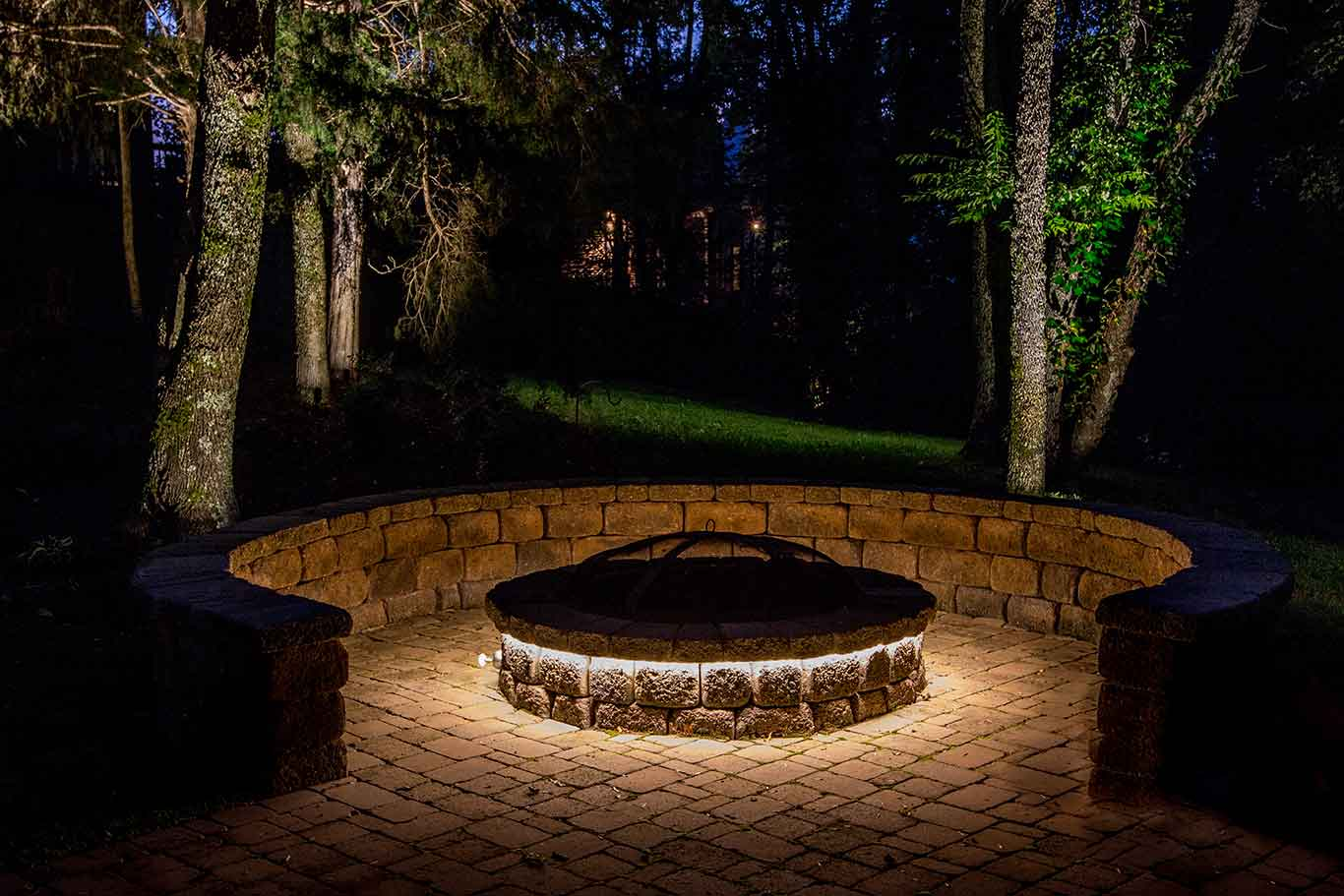 outdoor LED strip lighting around backyard firepit and outdoor living space