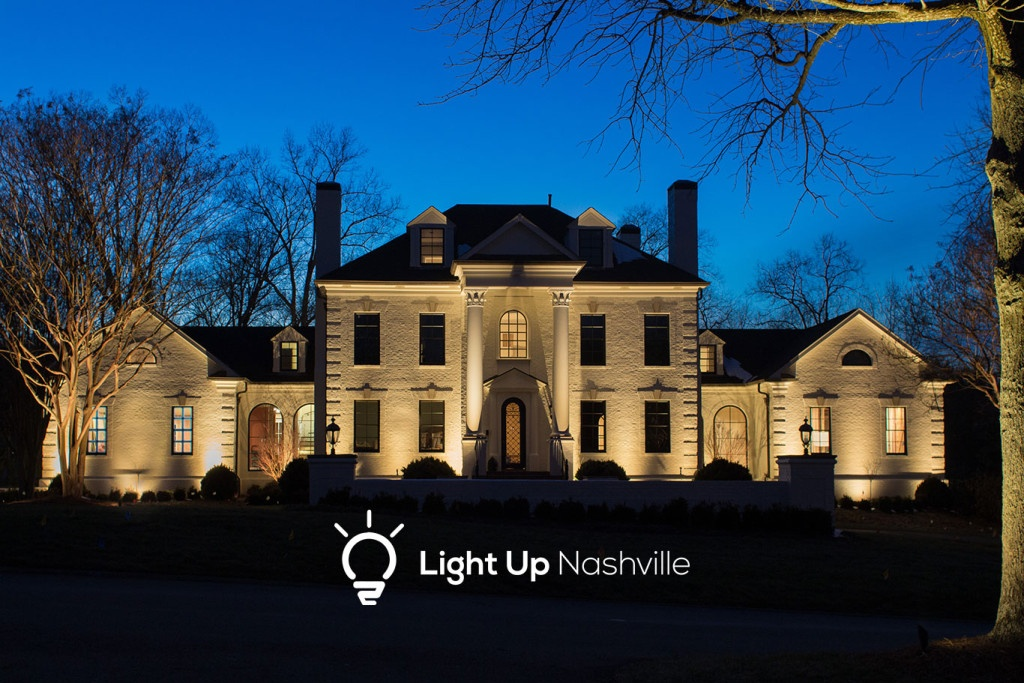 Architectural lighting to increase curb appeal on home in Brentwood with columns and features