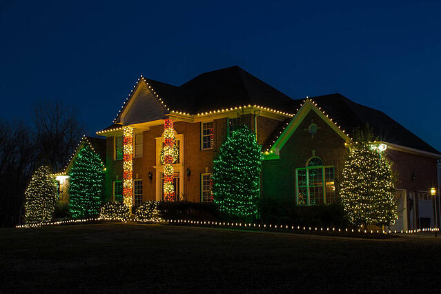 Holiday lighting with candy cane lights on columns
