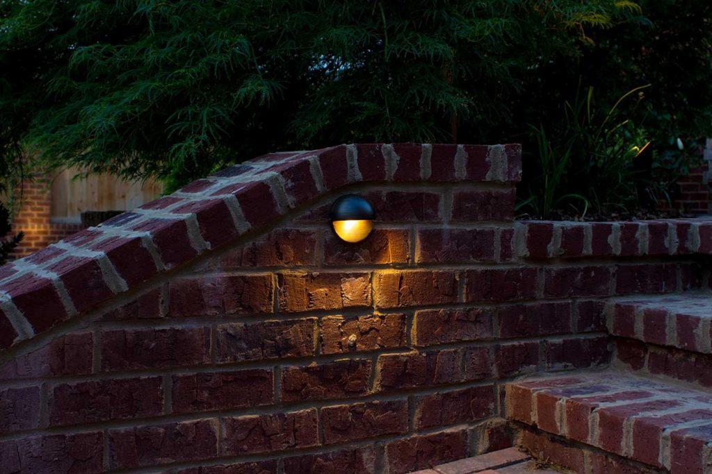Half moon LED fixture on stairs