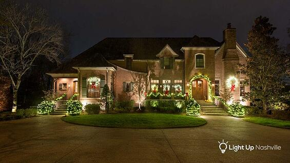 holiday lighting with garland and wreaths