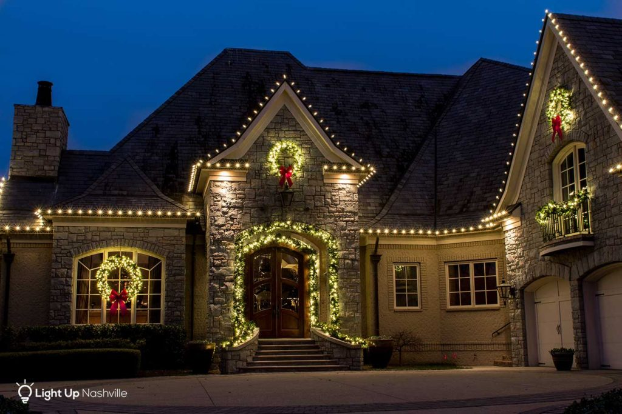 holiday lighting with garland around archway