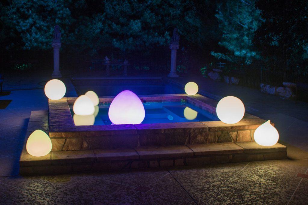 LED glow balls in teardrop floating in pool
