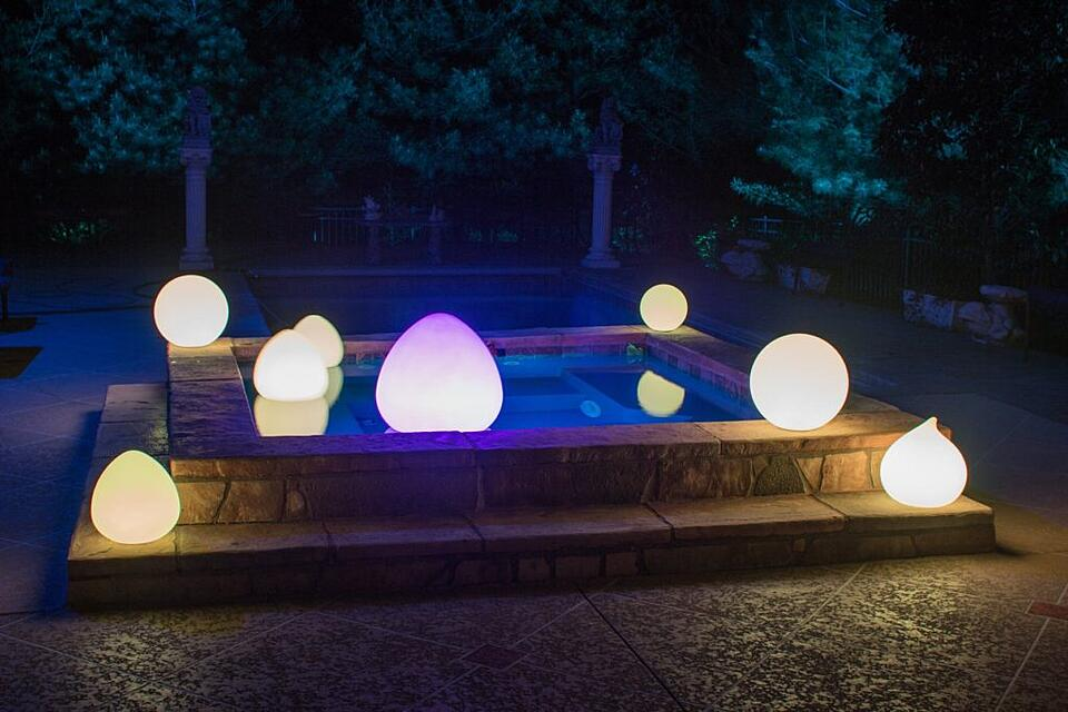 LED glow balls in teardrop floating in pool