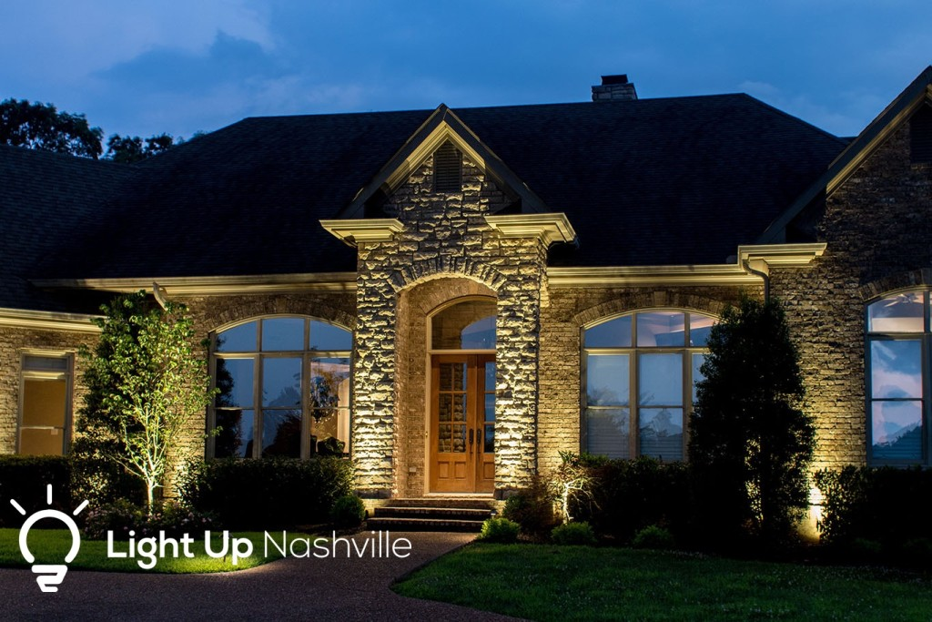 Front entry of home with good curb appeal lit by outdoor lighting from Light Up Nashville
