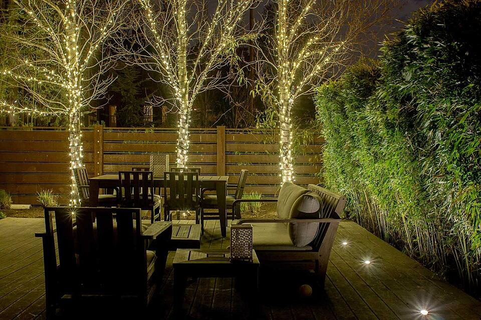 intimate deck lighting and permanent decorative string lights