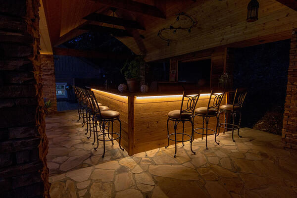 Strip lighting under outdoor bar