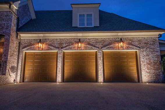 recessed in concrete well up lights lighting exterior of garage